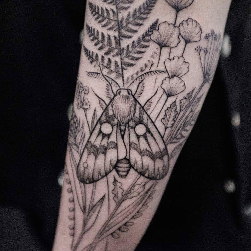 Moth between the plants tattoo