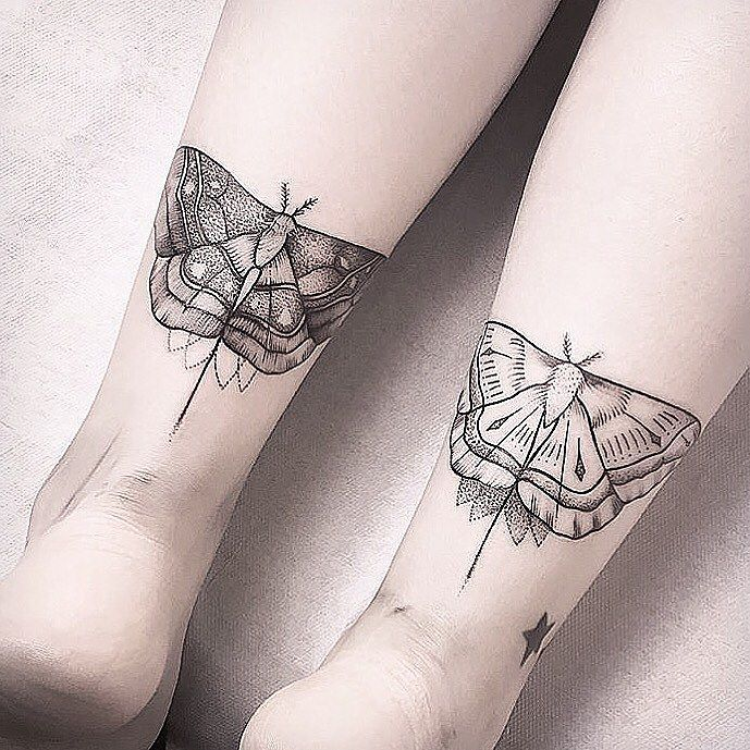 Moth tattoos on both ankles
