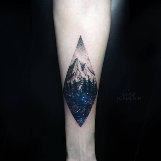 Mountainous landscape tattoo with the forest and cosmic background
