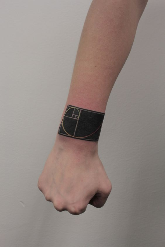 Negative space golden proportion tattoo on the arm