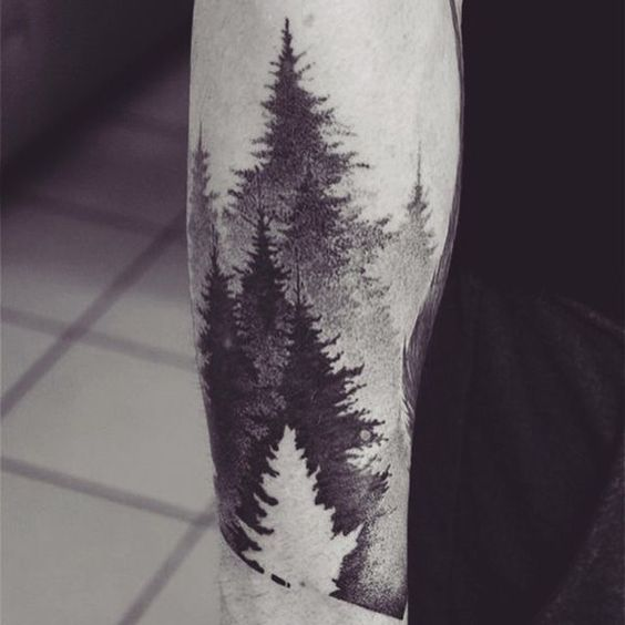Negative space gradient style woods tattoo