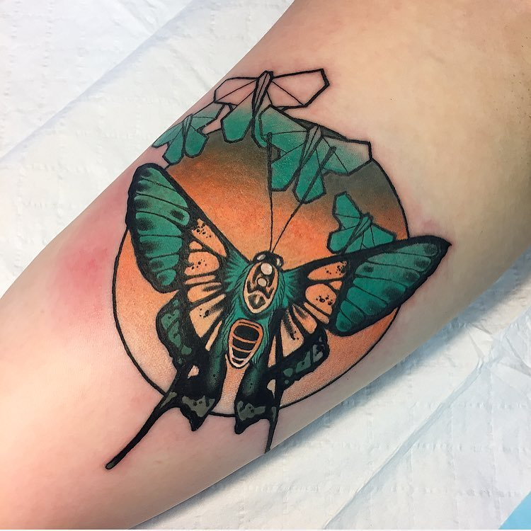 Neo traditional moth tattoo in a cirlce by alex bock