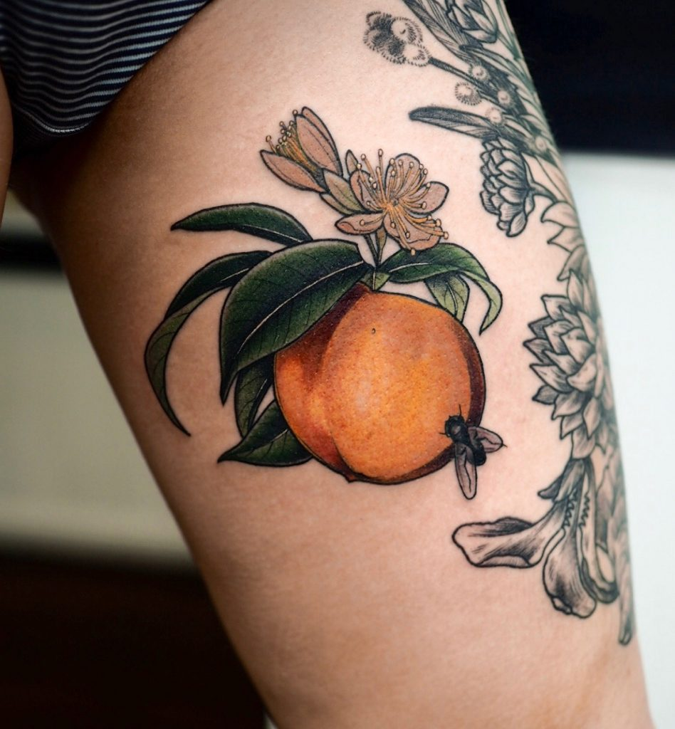 Neo traditional peach and fly tattoo on the upper thigh
