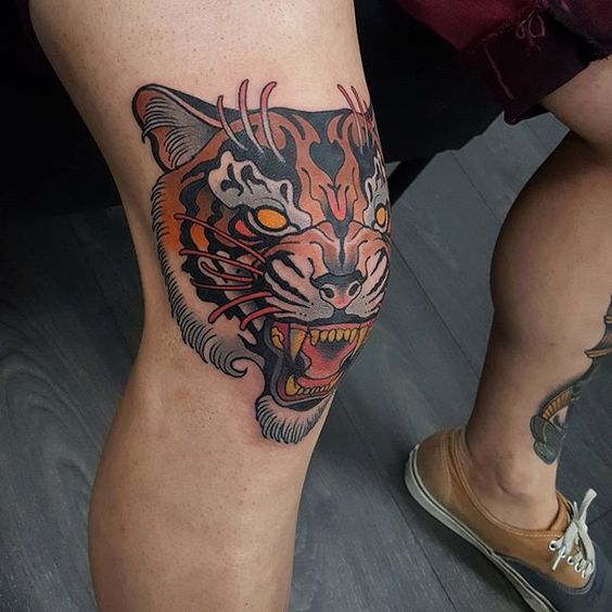 Neo traditional tiger tattoo on the knee