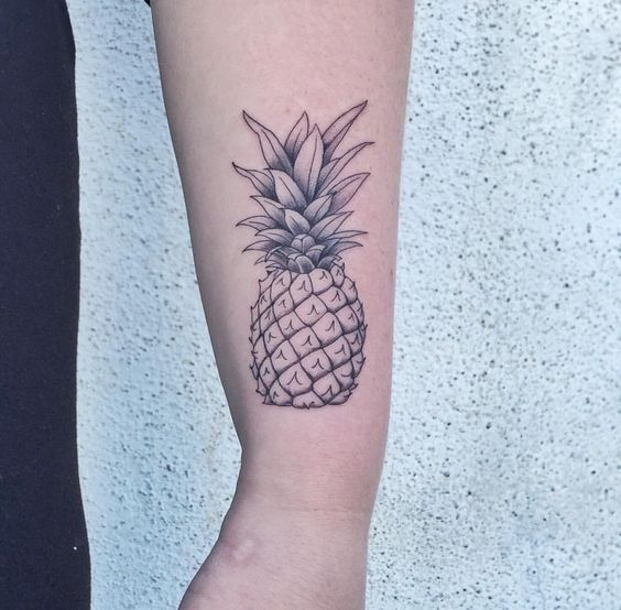 Nice pineapple tattoo on the forearm