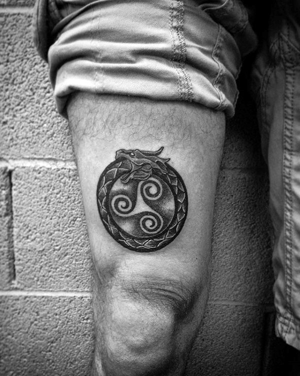 Nordic style ouroboros tattoo on the leg