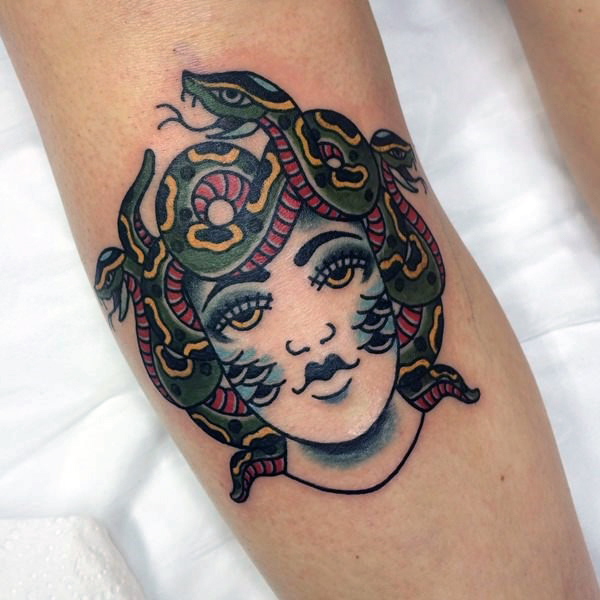 Old school medusa on the left calf