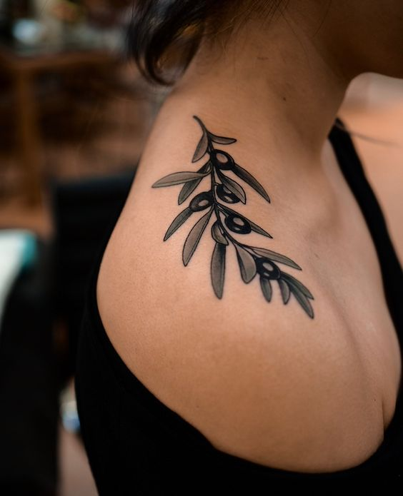 Olive twig shoulder tattoo