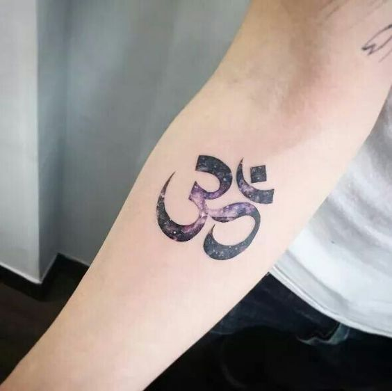 Om tattoo with a cosmic background