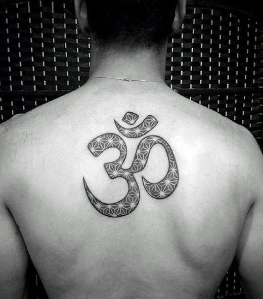 Ornamental om tattoo on the upper back