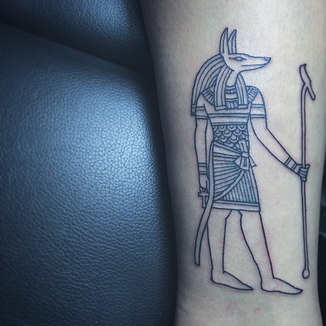 Outline anubis tattoo on the leg