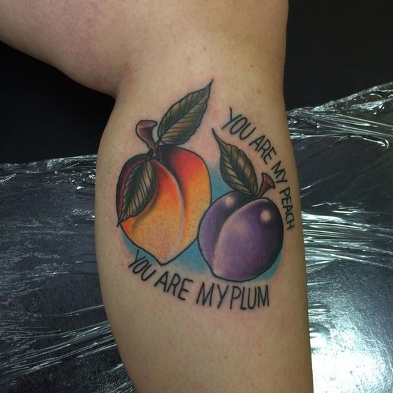 Peach and plum tattoo