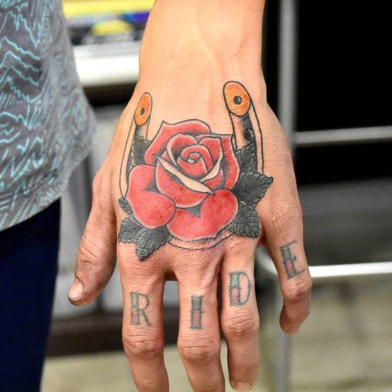 Rose and horseshoe on the left hand