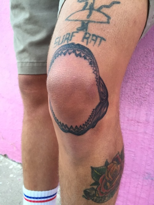 Shark jaws tattoo around the left knee