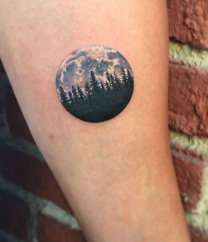 Small forest silhouette and night sky tattoo