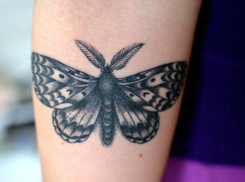 Small gypsy moth tattoo on the arm