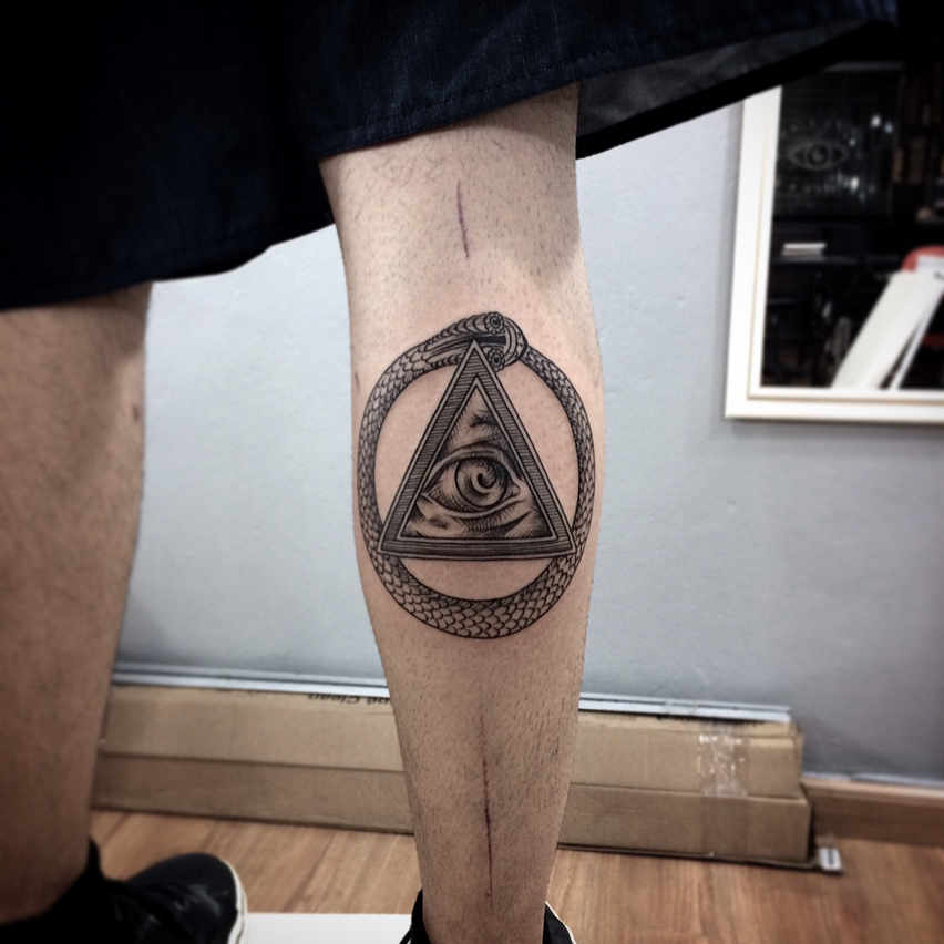 Snake ouroboros and allseeing eye tattoo