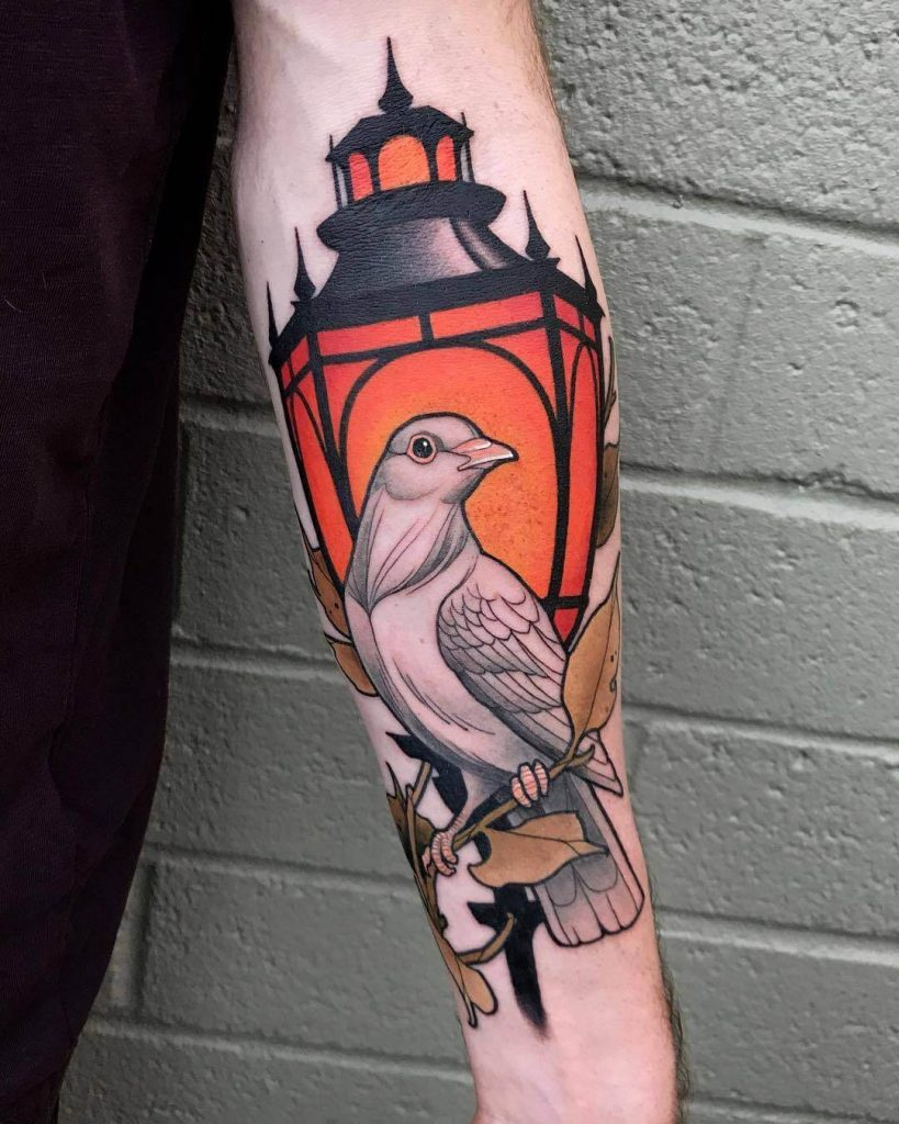 Street lantern tattoo with a dove