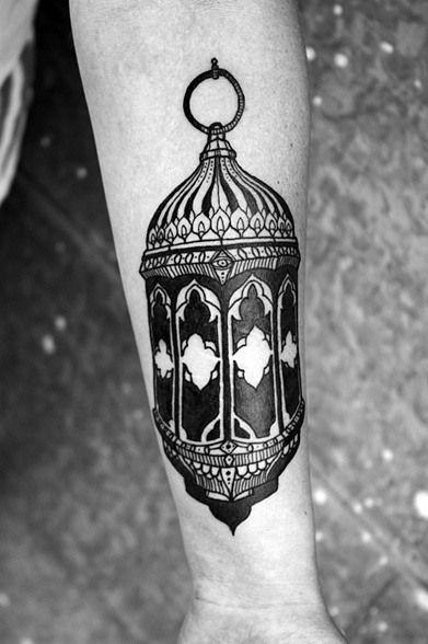 Stylized black lantern tattoo