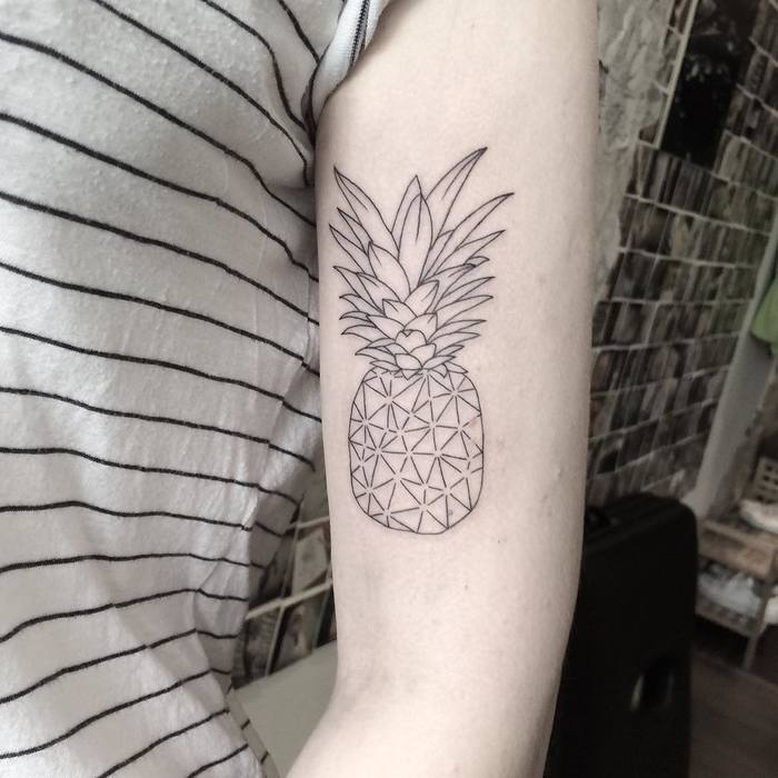 Subtle linear pineapple tattoo design