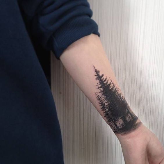 Taiga tattoo on the wrist and forearm
