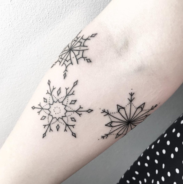 Three blackwork snowflakes