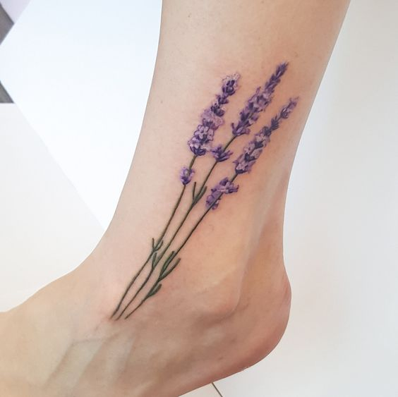 Three realistic lavenders tattoo on the left foot and ankle