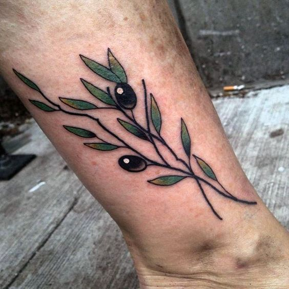 Traditional black olives branch tattoo on the ankle