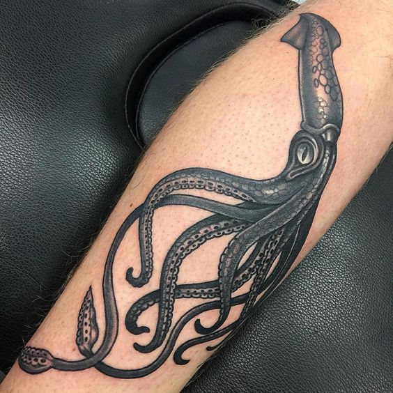 Traditional blackwork squid tattoo