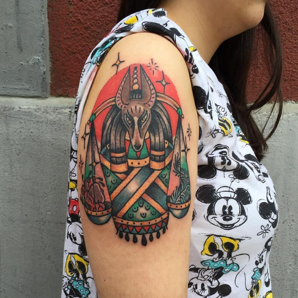 Traditional colored anubis on the right upper arm