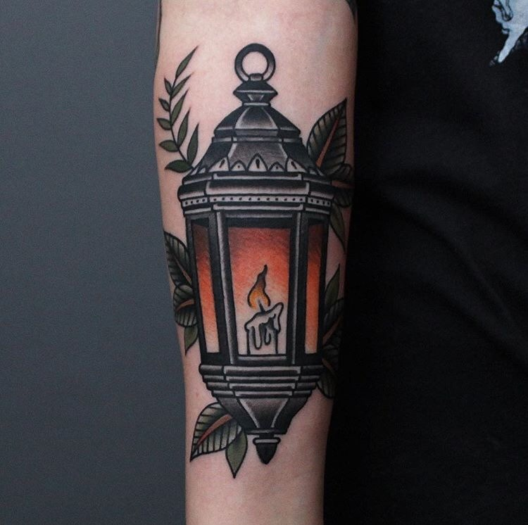 Traditional lantern tattoo on the right arm