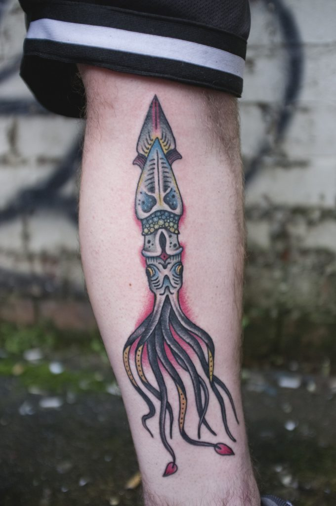 Traditional squid tattoo on the calf by james armstrong