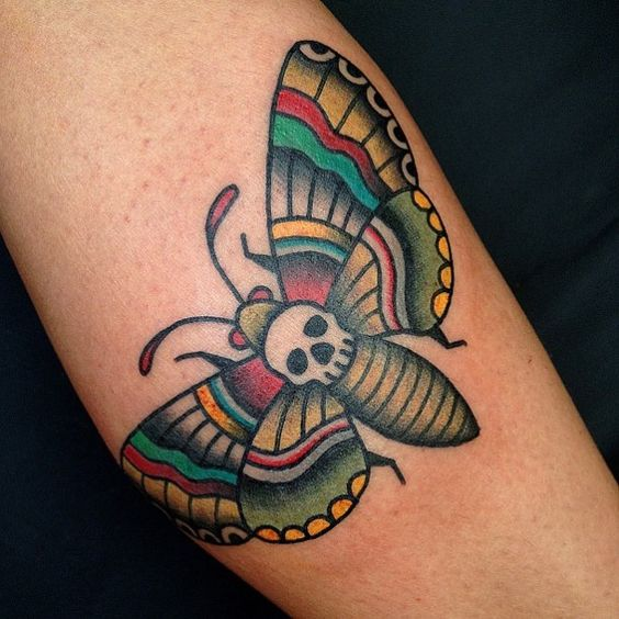 Traditional style moth tattoo