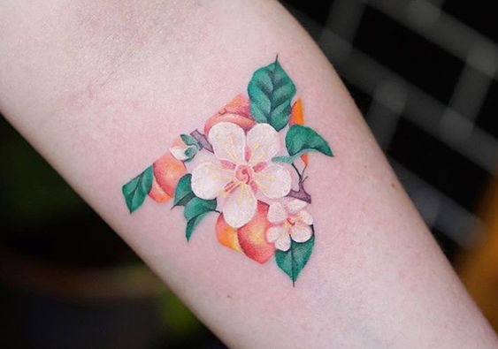 Triangular peach and its blossom tattoo