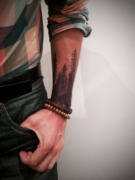 Woods tattoo on the left forearm