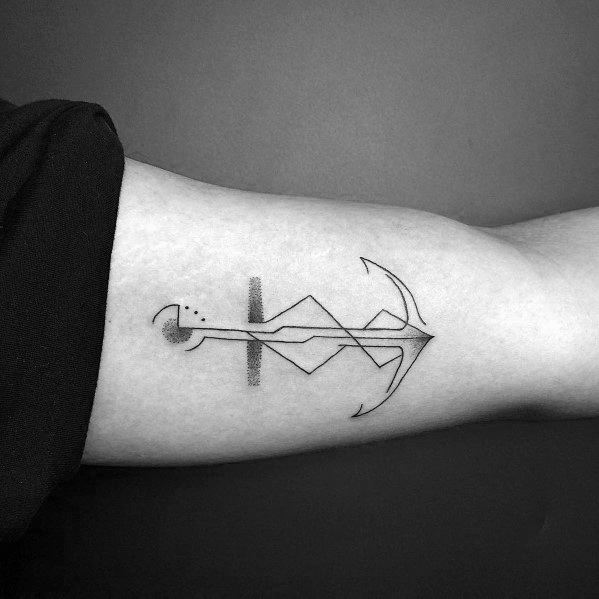 Abstract minimalist anchor tattoo on the bicep