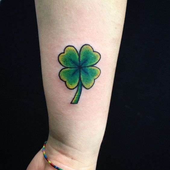Another green four leaf clover tattoo