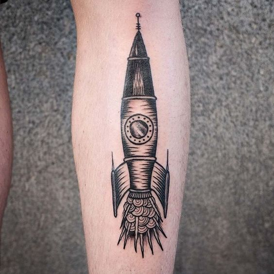 Black spaceship tattoo on the right calf