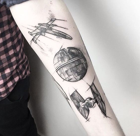 Black spaceships on the left forearm