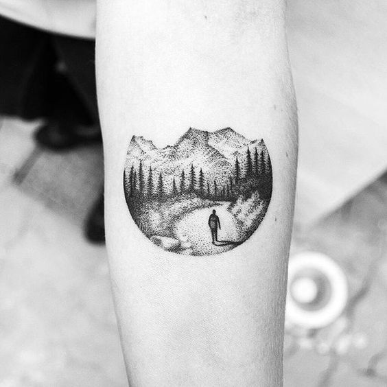 Circular dotwork landscape tattoo of a road in the mountains