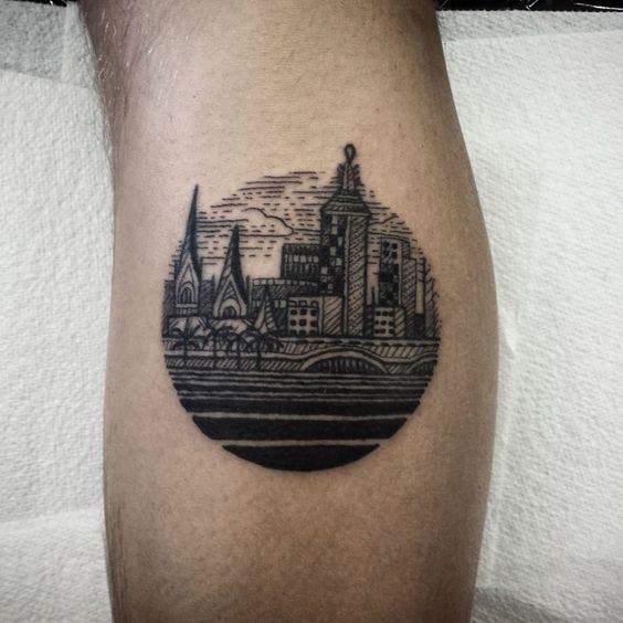Circular small city tattoo