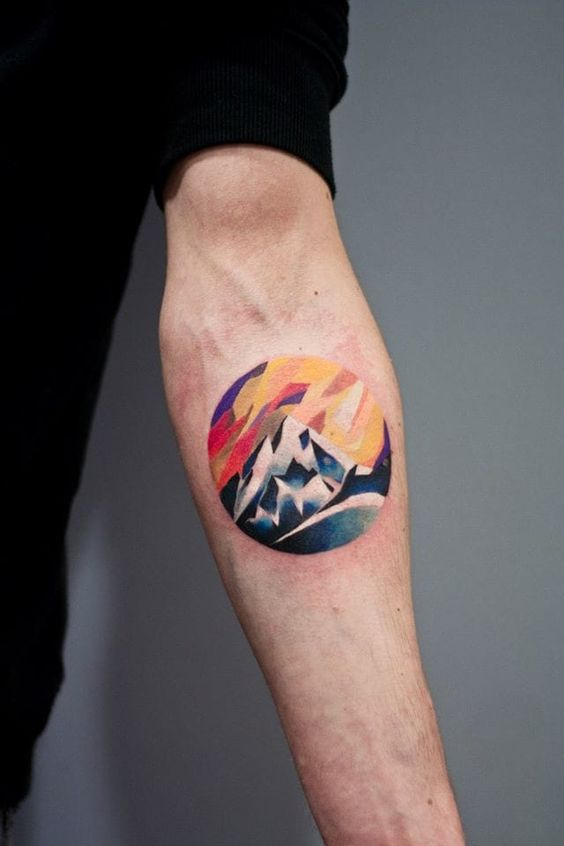 Colorful circular mountain tattoo