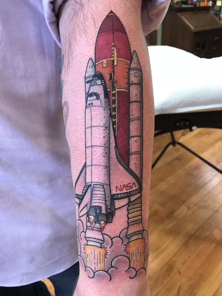 Cool nasa space shuttle tattoo on the forearm