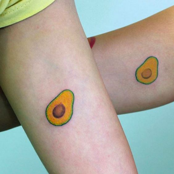 Cute matching avocado tattoos