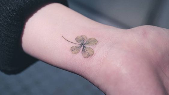 Delicate green clover on the wrist