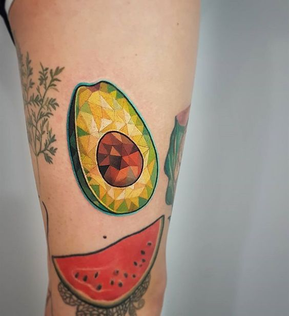 Geometric avocado tattoo on the thigh