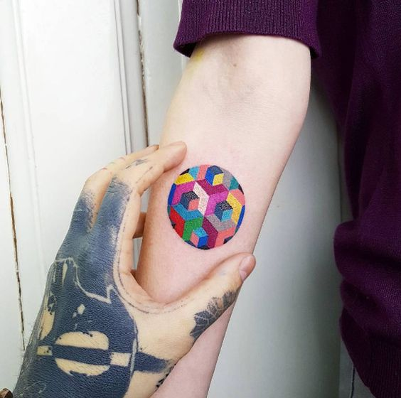 Geometric colorful circle tattoo