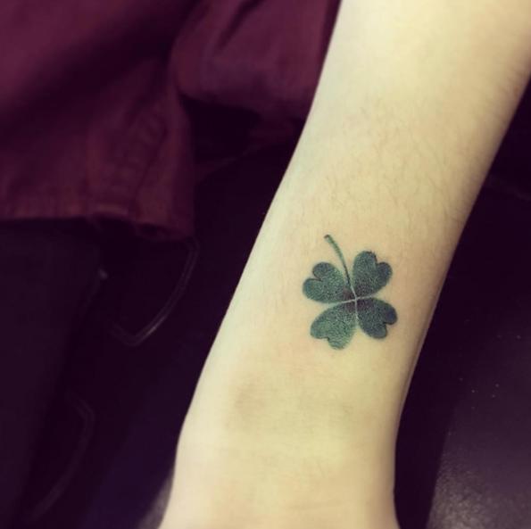 Green dotwork clover tattoo
