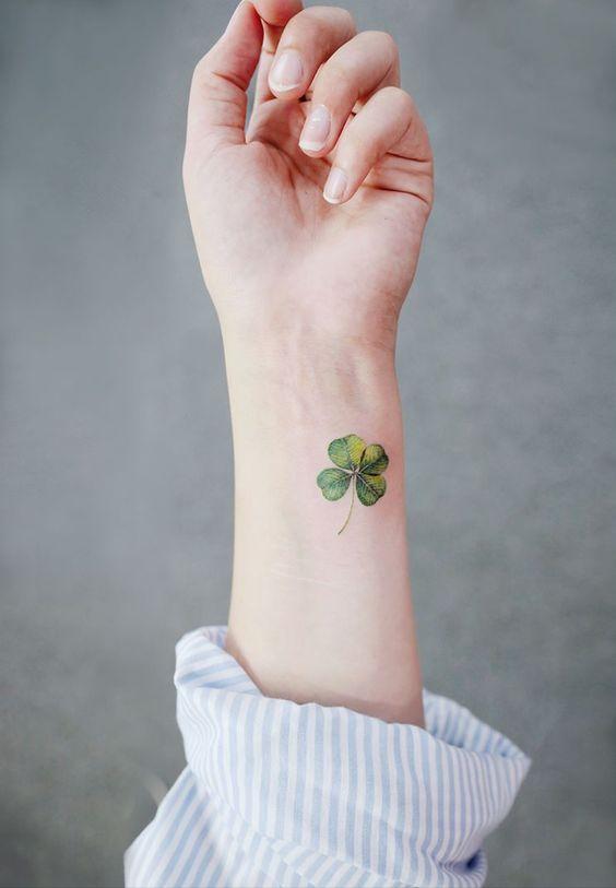 Hyper realistic green four leaf clover on the inner wrist