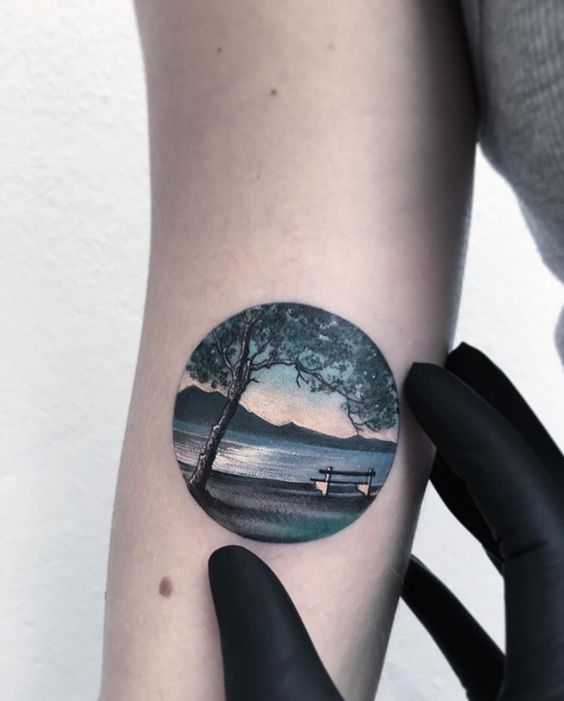 Lake landscape tattoo in a circle